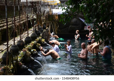 Bali, Indonesia- 18 Oct, 2019: People bathes in holy water originating from a volcanic spring at Tirtha Empul Temple in Tampaksiring Bali Indonesia.