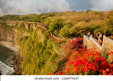 Bali, Indonesia - 19 August, 2018: The tourist path from the Uluwatu temple to the cliff over the precipice. Tourist attraction. Beauty of virgin nature.