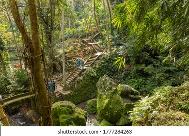 Bali, Indonesia - 30 June, 2019: People walking in the garden in Pura Goa Gajah. The temple, known as Elephant Cave, is located in Ubud and was originally created to be a sanctuary.