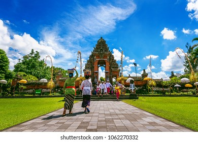 BALI, INDONESIA - APIRL 26, 2017 : Balinese people in traditional clothes during religious ceremony at Pura Taman Ayun Temple, Bali in Indonesia.