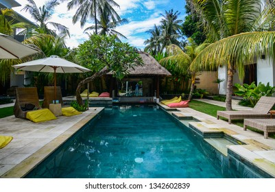 Bali, Indonesia - Apr 20, 2016. Swimming pool of resort in Bali, Indonesia. Bali is a popular tourist destination which has seen a significant rise since the 1980s.