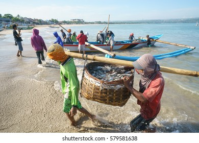 Bali Indonesia Apr 5, 2016: Morning scene of daily activities at Jimbaran village pictured on Apr 5, 2016 in Bali Indonesia. Jimbaran village is among famous place to see fisherman daily life in Bali.