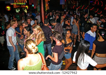 BALI, INDONESIA - APRIL 10: Revellers clubbing in one of the many nightclubs of Kuta, April 10, 2010, Kuta, Bali. Bali now receives over 6 million visitors a year.