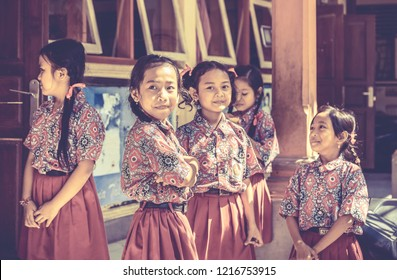 BALI, INDONESIA - APRIL 25, 2018: Young happy pupils wearing balinese school outfits at primary school on Bali island, Indonesia