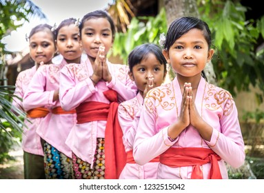 BALI, INDONESIA - APRIL 25, 2018: Small balinese dancers wearing beautiful outfits preparing for a performance on Bali Island, Indonesia