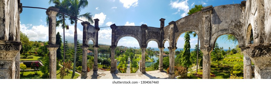 Bali / Indonesia - August 16th 2018: Taman Ujung Water Palace scenery with famous ruins in East Bali