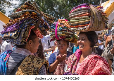 Bali, Indonesia - August 20, 2016: Balinese vendors selling sarongs during public cremation in Ubud, Bali, Indonesia.