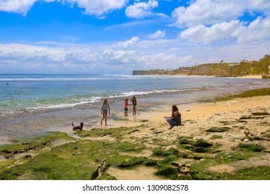 Bali, Indonesia - August 3, 2017 : Tourists relaxing on the beach in Kuta, Bali.