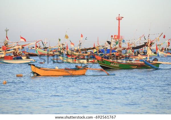 BALI, INDONESIA - AUGUST 3, 2017 : Colorful handcrafted Balinese wooden fishing boat at port in Jimbaran beach, Bali