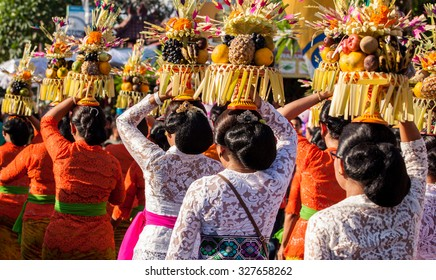 BALI, INDONESIA - AUGUST 30, 2015: Balinese villagers participating in Sanur Village Festival's street parade on August 30th, 2015 in Bali, Indonesia.