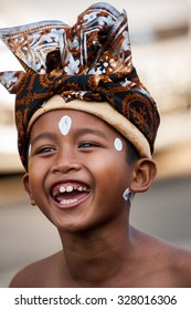 BALI, INDONESIA - AUGUST 30, 2015:  Balinese boy in traditional attire at Sanur Village Festival's street parade on August 30th, 2015 in Bali, Indonesia.