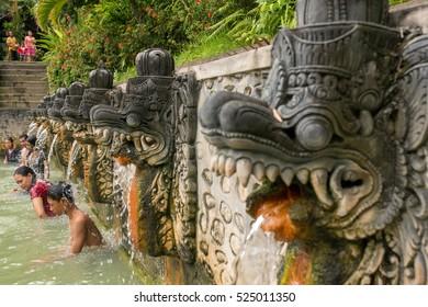 Bali, Indonesia - August 9, 2016: People take a bath in thermal Banjar Tega hot springs in Bali, Indonesia