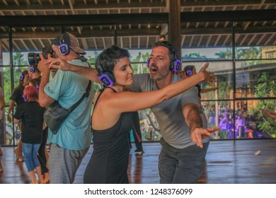Bali, Indonesia - December 1, 2018: Man and Woman Dancing Together with Arms Out during a Silent Disco