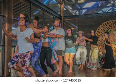 Bali, Indonesia - December 1, 2018: People Dancing in a Conga Line during Silent Disco Party