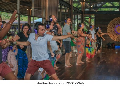 Bali, Indonesia - December 1, 2018: Group of Adults Freely Dancing with Headphones on in Silent Disco