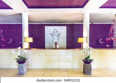 Bali, Indonesia - December 24, 2016:   Receptionist is welcoming guest at hotel reception at bali, indonesia