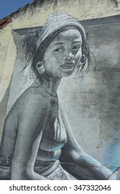 BALI, INDONESIA - December 5, 2015: Street graffiti of a young, topless Balinese woman on December 5, 2015 in Ubud, Bali, Indonesia.