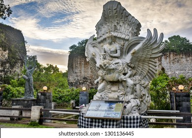 BALI, INDONESIA -Desemder 01, 2017: A devotee carries a fruit basket as offerings to Lord Vishnu at the Garuda Wisnu Kencana at Uluwatu, Bali Island.