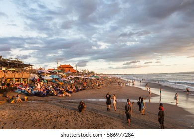 BALI, INDONESIA - FEBRUARY 18, 2017: A crowd of tourists and backpackers enjoy the sunset in a beach bar in Canggu beach, just north of Kuta and Seminyak in Bali, Indonesia