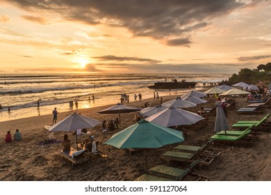 BALI, INDONESIA - FEBRUARY 18, 2017: People enjoy the sunset over Canggu beach, north of Kuta and Seminyak, in Bali in Indonesia. Canggu is popular with surfers and expats.