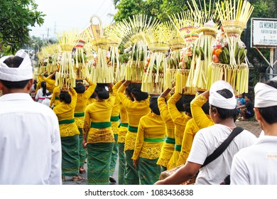 BALI, INDONESIA, FEBRUARY 2016: Balinese people parade on street during the Kuningan festival, one of the most important Bali Events and Festivals.