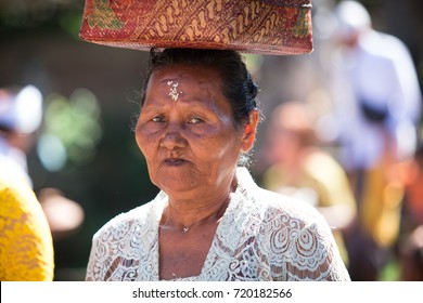 BALI, INDONESIA, FEBRUARY 2016: Old Balinese woman at Pura Dalem Puri Temple on FEBRUARY 19, 2016 in Bali, Indonesia during the Kuningan festival, one of the most important Bali Events and Festivals.