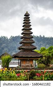 BALI, INDONESIA - February 2020: Pagoda at Beratan Water Temple on cloudy day in Bali, Indonesia