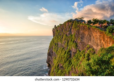 BALI, INDONESIA - FEBRUARY 8, 2013: Sunset at Uluwatu temple. This famous Hindu temple dates back to the 11th century.