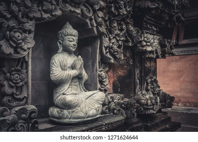 BALI, INDONESIA - JANUARY 12, 2018: Stone Buddha sculpture outdoor on Bali, Indonesia