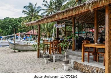 "BALI, INDONESIA - JANUARY 14, 2018: Small cafe warung ""Jepun Bali"" at tropical beach in Bali near Chandidasa, knowen as White Sand Beach."