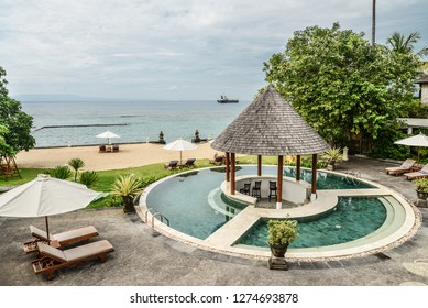 BALI, INDONESIA - JANUARY 14, 2018: Territory Discovery Candidasa Cottages and Villas Hotel with swimming pool and sea view at sunny day, Bali, Indonesia