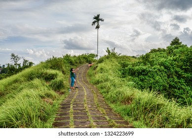 BALI, INDONESIA - JANUARY 18, 2019: Tourists walk and take pictures along the beautiful Campuhan Ridge Walk just outside of Ubud, Bali, Indonesia.