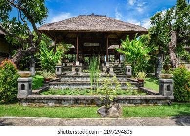 "BALI, INDONESIA - JANUARY 5, 2018: Luxury hotel ""Puri Bagus Lovina Villa Resort & Spa"" territory with bungalows on Bali island, Indonesia"