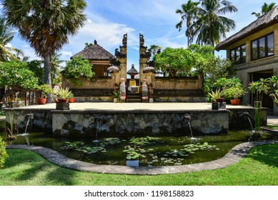 "BALI, INDONESIA - JANUARY 5, 2018: Luxury hotel ""Puri Bagus Lovina Villa Resort & Spa"" territory with temple on Bali island, Indonesia"