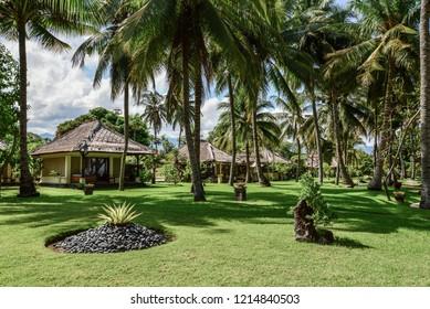 "BALI, INDONESIA - JANUARY 5, 2018: Luxury hotel ""Puri Bagus Lovina Villa Resort & Spa"" territory on Bali island, Indonesia"