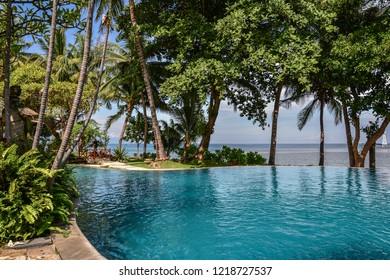"BALI, INDONESIA - JANUARY 5, 2018: Luxury hotel ""Puri Bagus Lovina Villa Resort & Spa"" territory with swimming pool on Bali island, Indonesia"