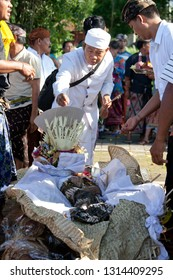 Bali, Indonesia - january 8, 2016: priest performing ceremony of cremation before burning dead body, traditional funeral ceremony