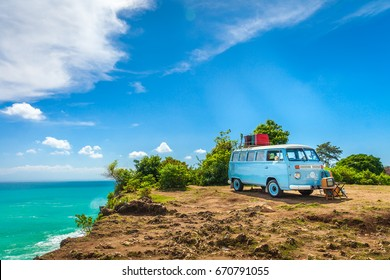 BALI, INDONESIA, Jimbaran beach - May 1, Editorial Use Only: Summer vacation on tropical island on the background vintage car van bus volkswagen with suitcase, beautiful nature with sea ocean water