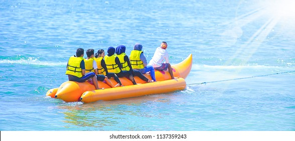 BALI INDONESIA, JULY 17 2018 : Groub of people ride Banana boat sunlight morning in Tanjung Benoa Bali