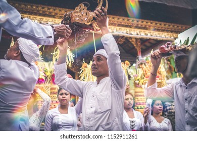 BALI, INDONESIA - JULY 4, 2018: Group of people on a balinese village ceremony.