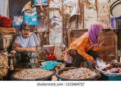 BALI, INDONESIA - JULY 9, 2017: Local trader at the Pasar Seni Kumbasari in Badung, Bali on July 4, 2017.