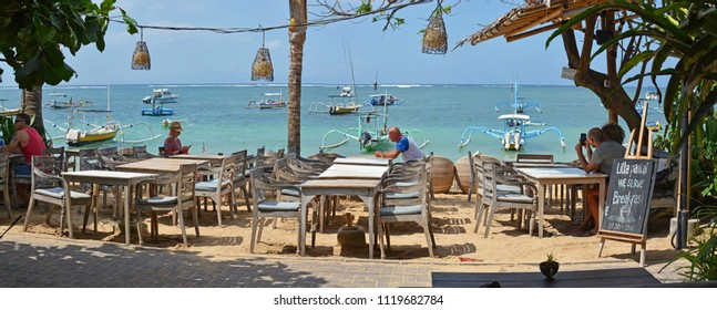 Bali, Indonesia - June 03, 2018; Beachside Restaurant Panorama at Sanur beach in the afternoon.