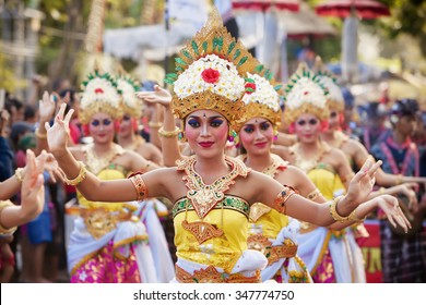 BALI, INDONESIA - JUNE 13, 2015: Women group dressed in colorful sarongs - Balinese style female dancer costume, dancing traditional temple dance Legong at Bali Art and Culture Festival show