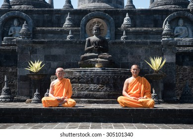 BALI, INDONESIA - MAR 26: Buddhist monks praying in Brahma Vihara Arama Buddhist Monastery 26 March 2015 in Bali, Indonesia