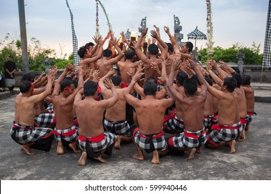 Bali, Indonesia - March 03, 2013: Kecak dance is a traditional ritual of Bali, Indonesia.This dance is being shown at Uluwatu Temple.Blurred appearance of flowing dance.