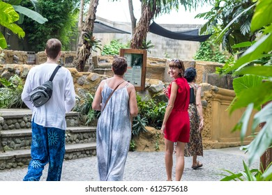BALI, INDONESIA - March 23, 2017: Happy smiling tourists in the tropical Bali island Zoo park, Indonesia.