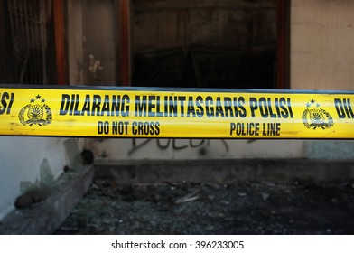 BALI. INDONESIA - March 25, 2016: A 'Police Line - Do Not Cross' tape in Indonesian sealing off a recent market fire on March 25, 2016 in the tourist village of Ubud, Bali, Indonesia.
