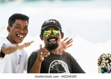BALI, INDONESIA - MARCH 29, 2016: Two men on the beach with a colored sunglasses. Bali