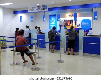BALI, INDONESIA - MAY 12, 2017 : Customers and bank tellers inside an Indonesian bank.