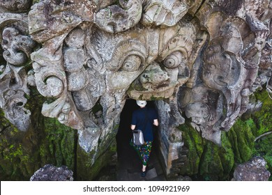 Bali, Indonesia - May 20, 2018: High angle view of tourist entering the ancient Goa Gajah Elephant Cave temple in Ubud, Bali, Indonesia.